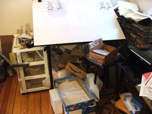My drafting table, cluttered up.