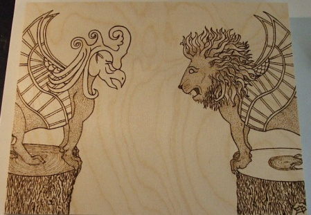 Photo of woodburn art, a griffin and a winged lion, without color.